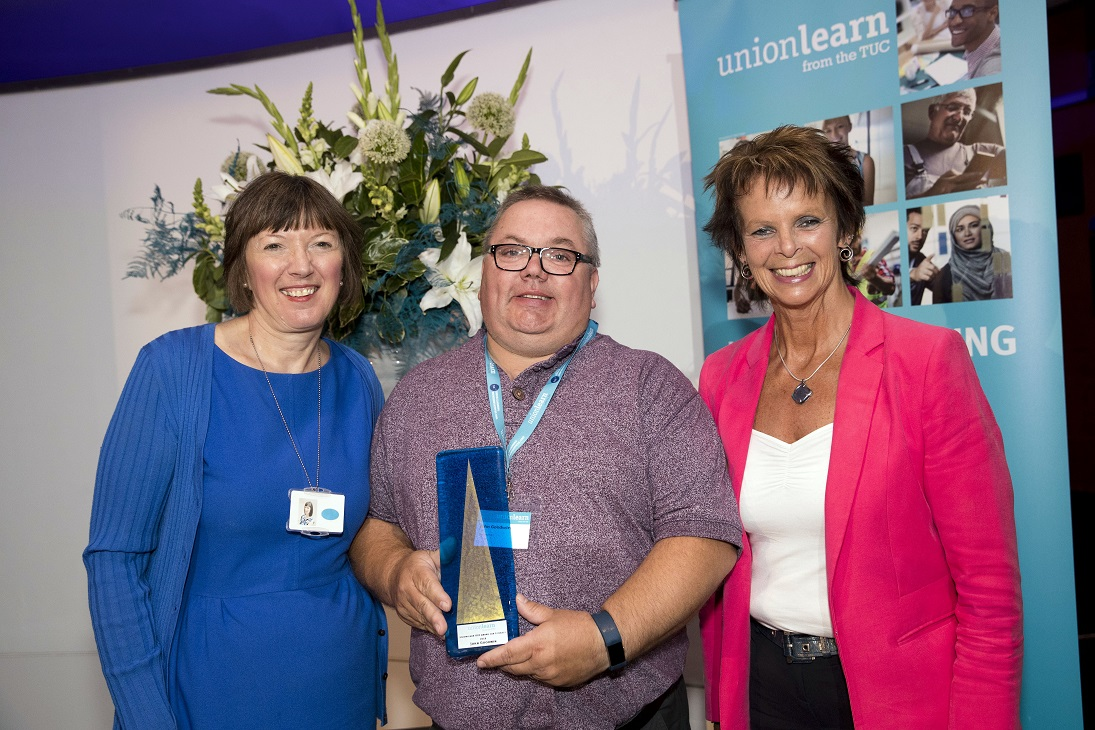 Usdaw ULR John Goodwin collects award from Frances O'Grady and Anne Milton MP