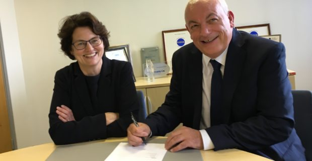 Axia and Community sign learning agreement