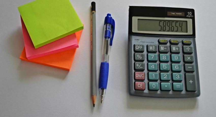 calculator and pens